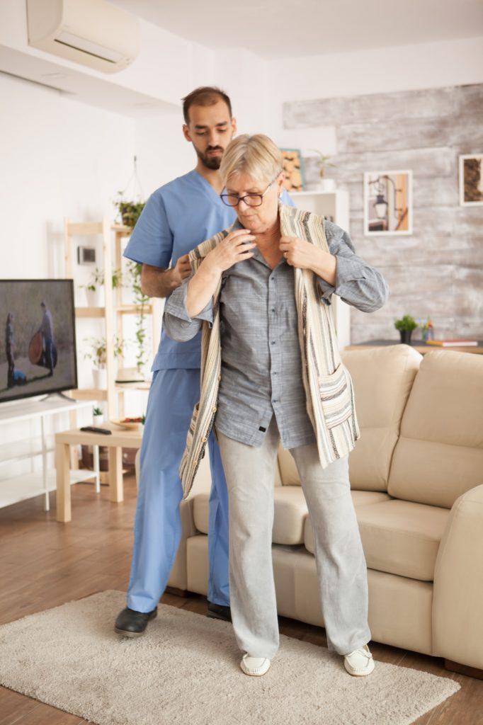 Male doctor in nursing home wearing blue uniform